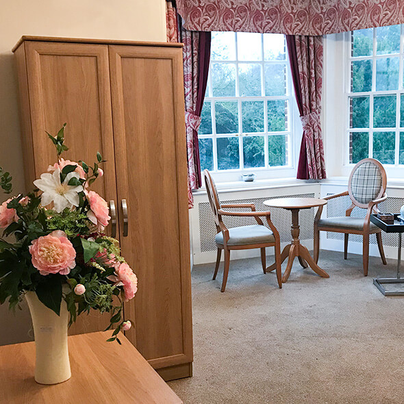 interior of room with flowers on table couples care