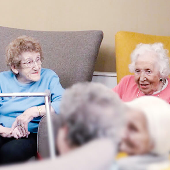 two residents sitting together residential care
