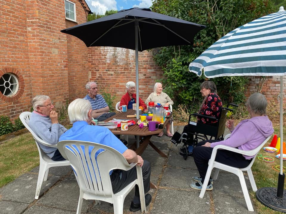 Residents Enjoying Ice Creams, Biscuits and Tea in the New Garden Area
