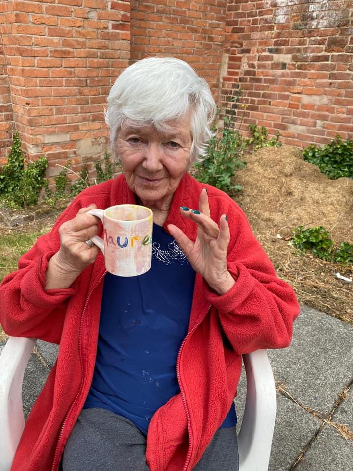 Resident Enjoying Tea in the New Garden Area