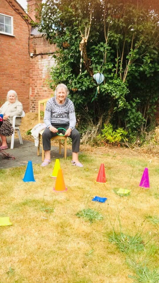 Resident Playing Games Outdoors in the New Garden Area