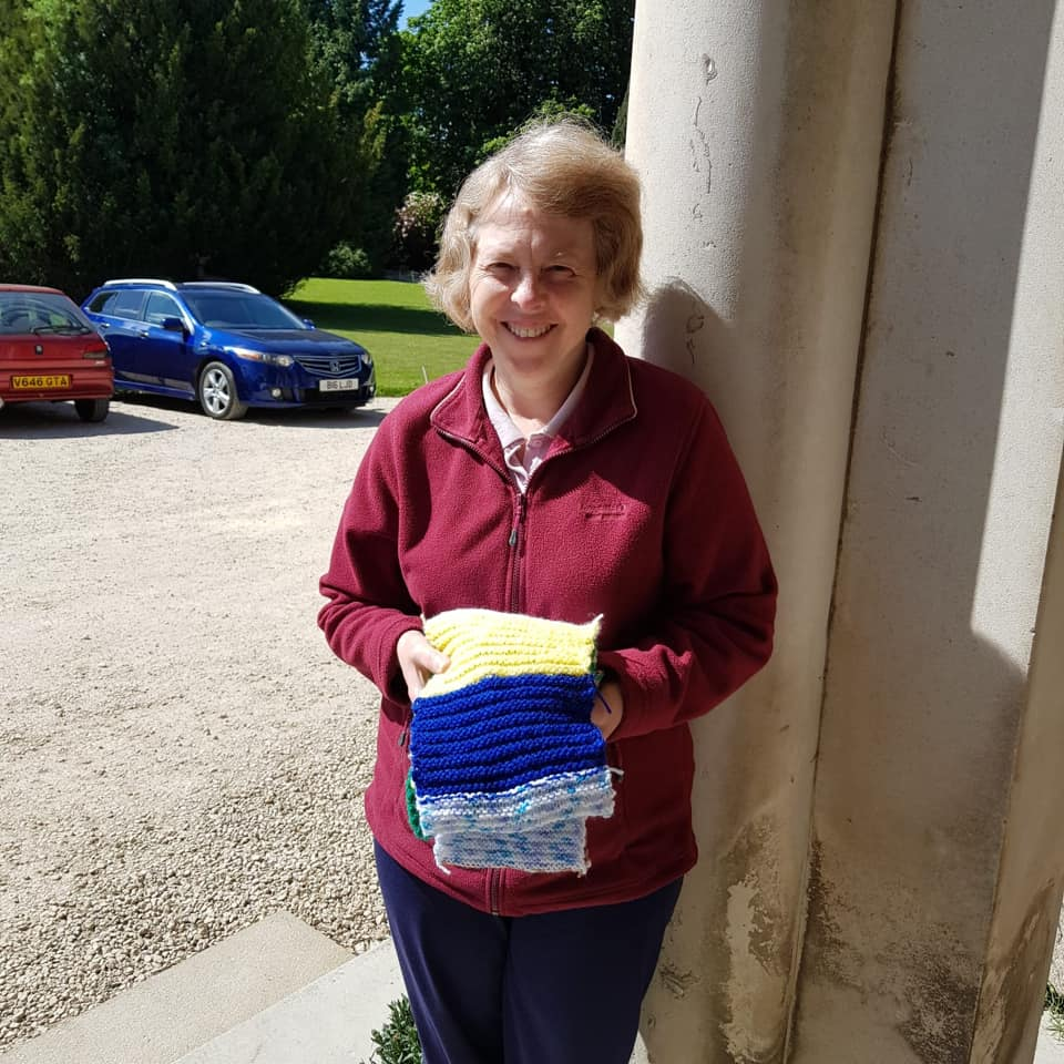 Ruth Chidlow with Knitted Scarves Donation